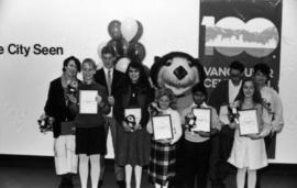 Tillicum poses with contest winners