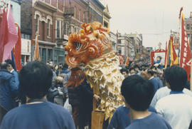 Crowd watching dragon dance during Chinese New Year celebration on East Pender Street