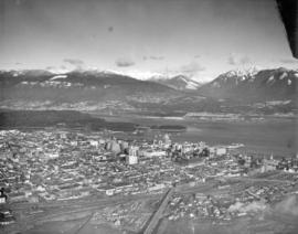 [Aerial photograph of downtown Vancouver looking north]