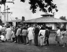 1966 prize home : [queue outside of 1966 P.N.E. program grand prize house]