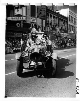 Gizeh Temple Shriners in car during 1956 P.N.E. Opening Day Parade