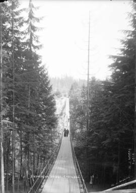 [Man and woman on] suspension bridge, Capilano