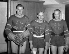 Three players from the Vancouver Burrards lacrosse team