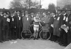 Harry Gale [shaking hands with cyclist]