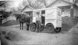 [Douglas Paterson in front of Manor Bakers delivery wagon]