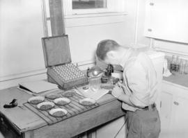 Turner Valley Oil - Geologist B. Perry with samples of ore