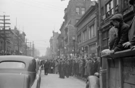 [Spectators on Pender Street for funeral procession]