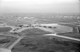 Aerial view of airport terminal, runways and approaches to Sea Island