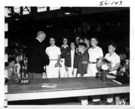 P.N.E. Past President J.S.C. Moffitt presenting award at awards ceremony for 1956 P.N.E. 4-H and ...