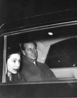 [Her Majesty Queen Elizabeth and His Royal Highness Prince Philip in a car]