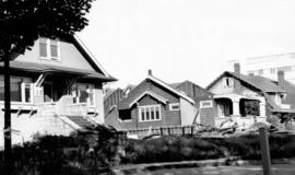 [Houses in the 2000 block Comox Street being demolished]