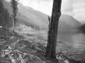 Coquitlam Dam looking north towards tunnel camp on west shore of lake showing ground cleared and ...