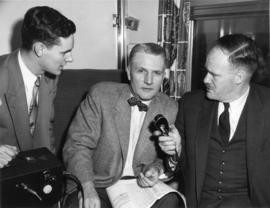 "[C.P.R. President N.R.C. Crump (middle) being interviewed during the launch of ""The Canadian..."