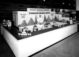 Standard Brands display of baking powder, tea, and coffee products