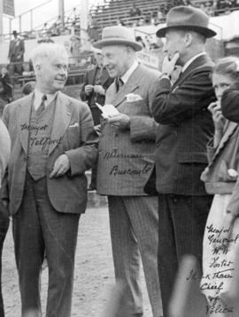 [Mayor Lyle J. Telford, Alderman Buscombe and W.W. Foster at a stadium]
