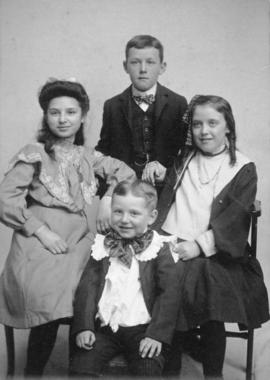 [Studio portrait of four children]