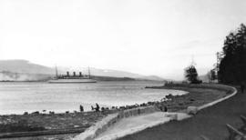 "[View from seawall in Stanley Park - Canadian ""Empress"" liner entering harbour]"