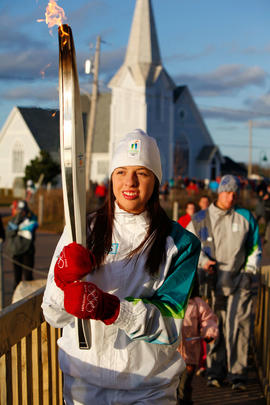 Day 24 Torchbearer 116 Shelby-Lynn Arsenault carrying the flame in Lennox Island, Prince Edward I...