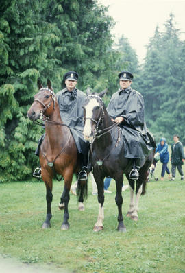 Two police officers on horseback during the Centennial Canada Day celebration