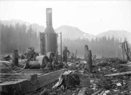 [Man operating winch in partially cleared area for construction of Buntzen Lake Power Plant numbe...