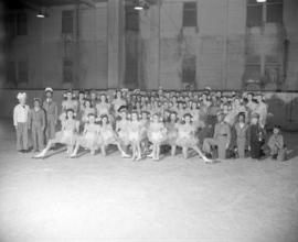 [Group portrait of young skaters in costume at the Rotary Ice Carnival]
