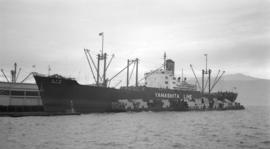 S.S. Yamashita Maru [at dock, with lumber-filled barges alongside]