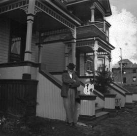 C.T.W. Piper [in front of his] residence - 1768 Robson Street near Denman Street
