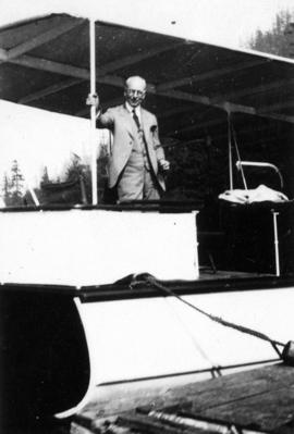 [L.D. Taylor standing on a docked boat]