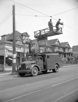 B.C. Electric Railway trolley truck [near] the corner of Davie Street and Denman Street stringing...