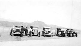 [Board of Trade trip - Automobiles parked along river]