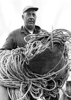 Close-up of Captain John Strand with nets