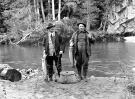 [Two men holding fish]