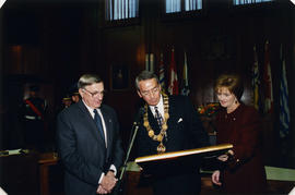 Mayor Philip Owen presenting Roméo LeBlanc and Diana Fowler LeBlanc with Susan Point print