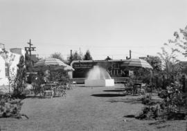 Garden area adjacent to dairy buildings and ice cream parlor, 2256 West Broadway