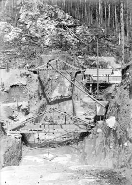 [Workers and scaffolding at partially constructed Buntzen Lake Power Plant number one]