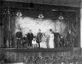 [Group portrait of actors on stage in City Hall on Westminster Avenue (Main Street)]