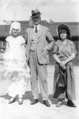 [Mayor L.D. Taylor with children in costume]