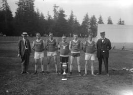 "Caledonian Games [""Elks"" team with trophy]"