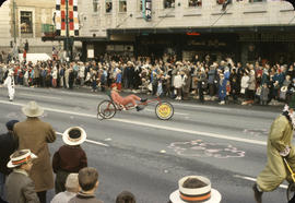 48th Grey Cup Parade, on Georgia and Howe, man riding Cap's Bicycles Recumbent bicycle