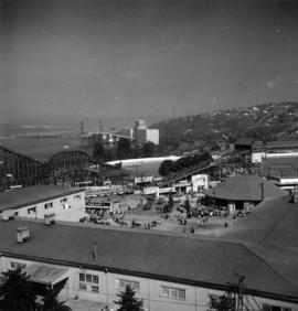View of Forestry and Indian building, as well as amusement rides and tents in midway carnival on ...