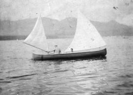 [Two men boating in Burrard Inlet]