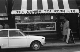 The Danish Tea Room and a parked car across Robson Street