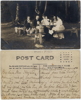 [Group eating at a picnic table, Stanley Park]