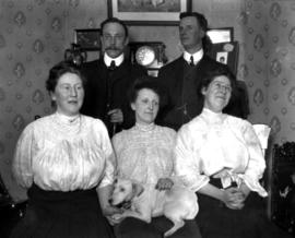 Group portrait with Mr. and Mrs. MacKinnon and dog