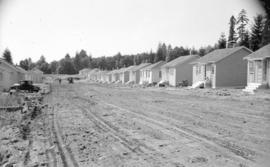 [Row of houses built as  part of a shipyard housing program in North Vancouver]