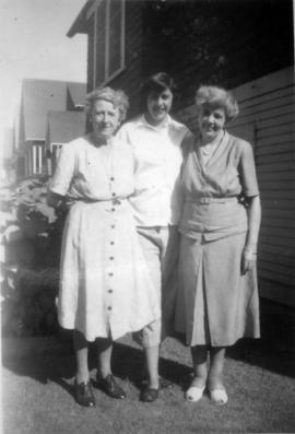 L to R: Florrie Wilson, Marion Armstrong and Doris Armstrong [standing beside 3500 Willow Street,...