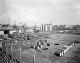 [B.A. Oil Company plant showing storage tanks and oil barrels]