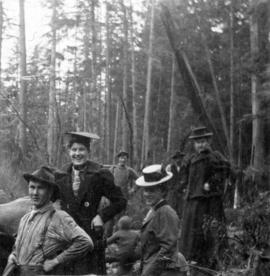 [Unidentified men and women at logging camp]