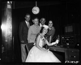 Carol Lucas, Miss P.N.E., with radio equipment for P.N.E. radio station, VE7PNE