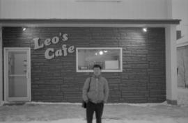 Young man standing at the site of his father's café on Centre Street in Naicam, Saskatchewan